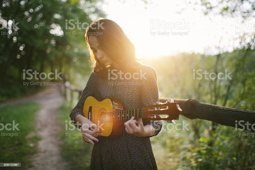 Girl with ukulele stock photo