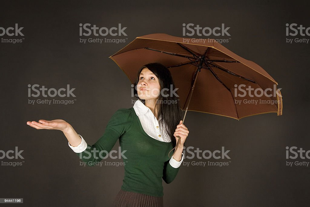 Girl with umbrella checking for rain royalty-free stock photo