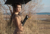 girl with umbrella in autumn