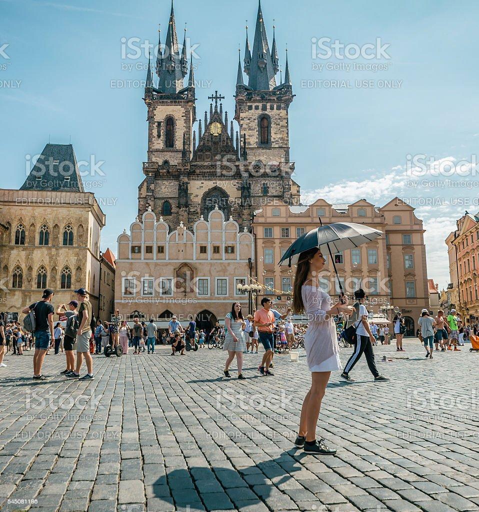 Girl with Umbrella - Old Toqn Square stock photo