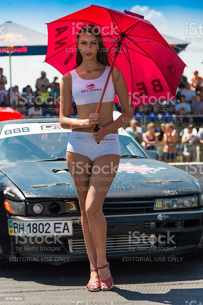 Girl with umbrella posing near Drift Car stock photo