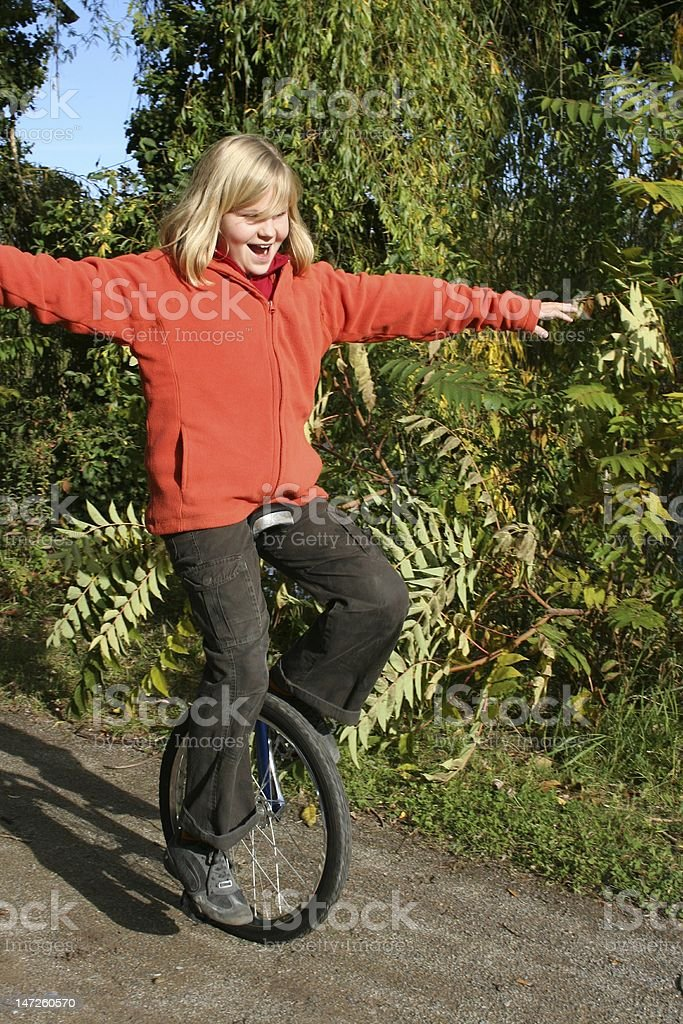 Girl with unicycle royalty-free stock photo