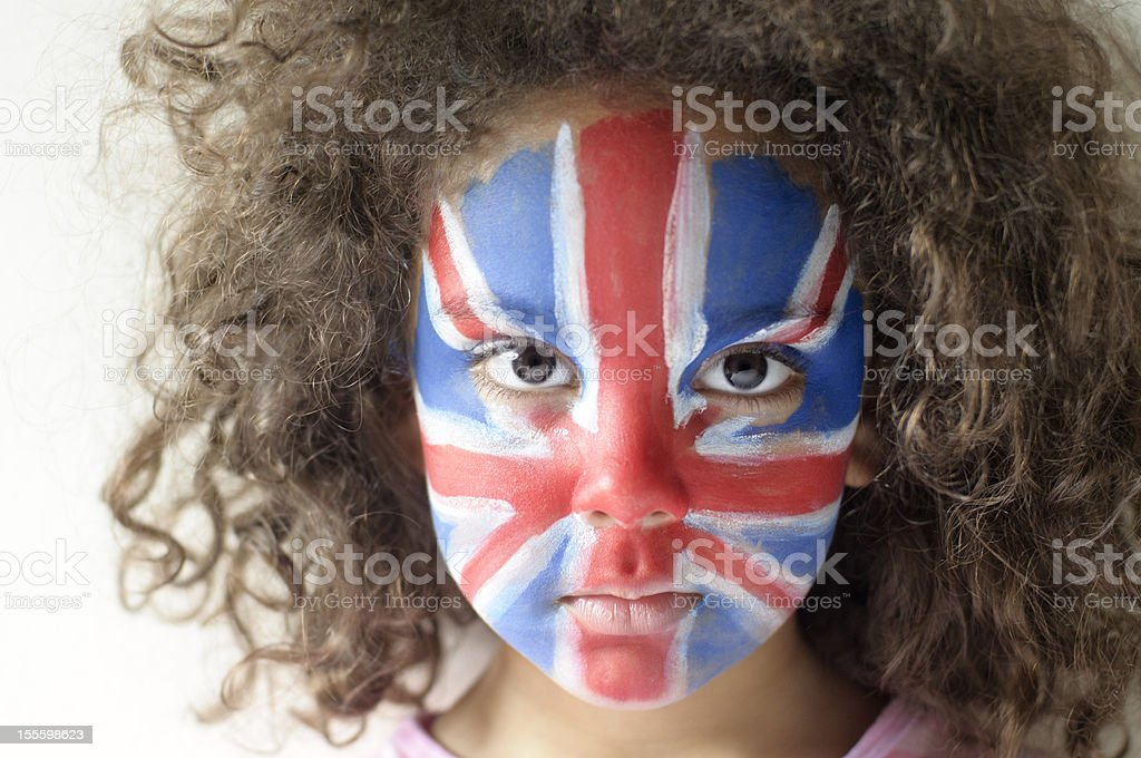 Girl (5-6) With Union Jack Face Painted Looking Serious royalty-free stock photo