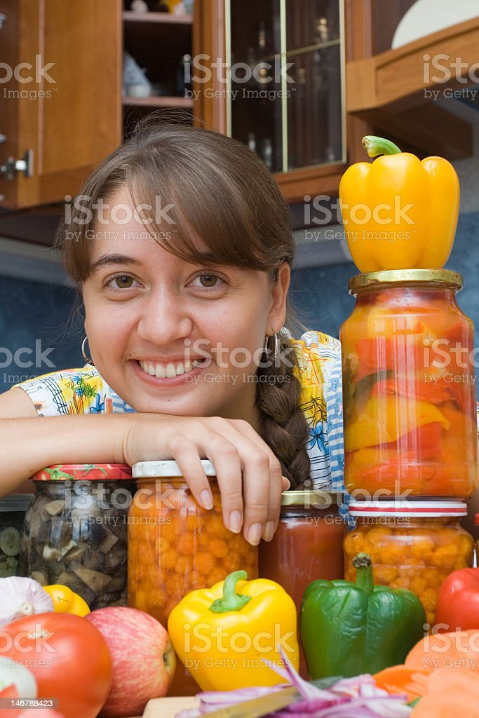 Girl with vegetables and jars royalty-free stock photo