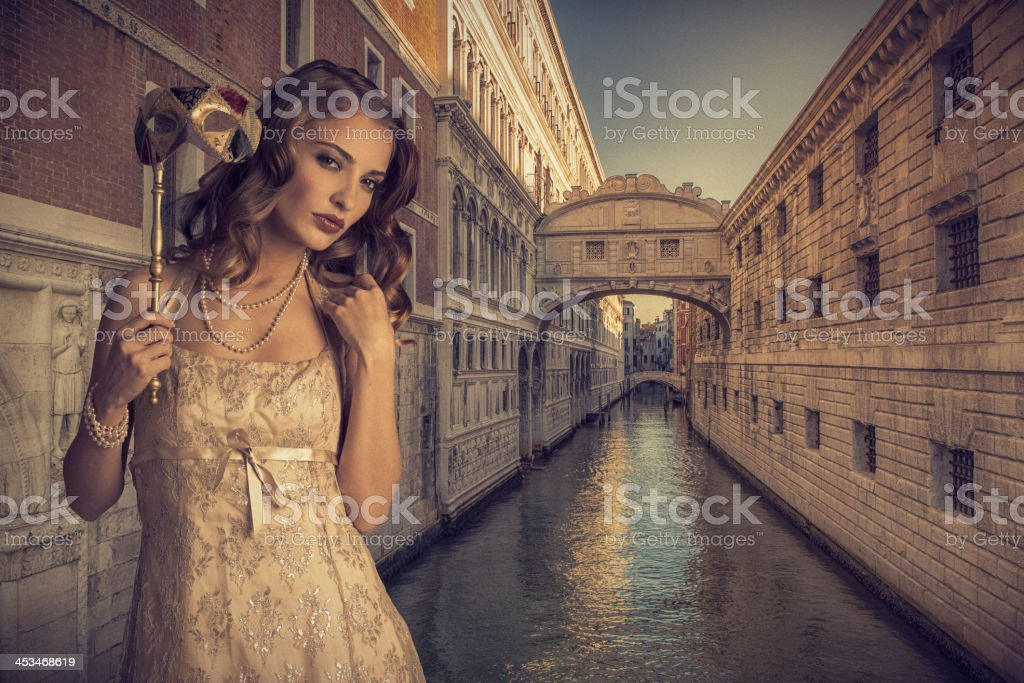 girl with venetian mask stock photo