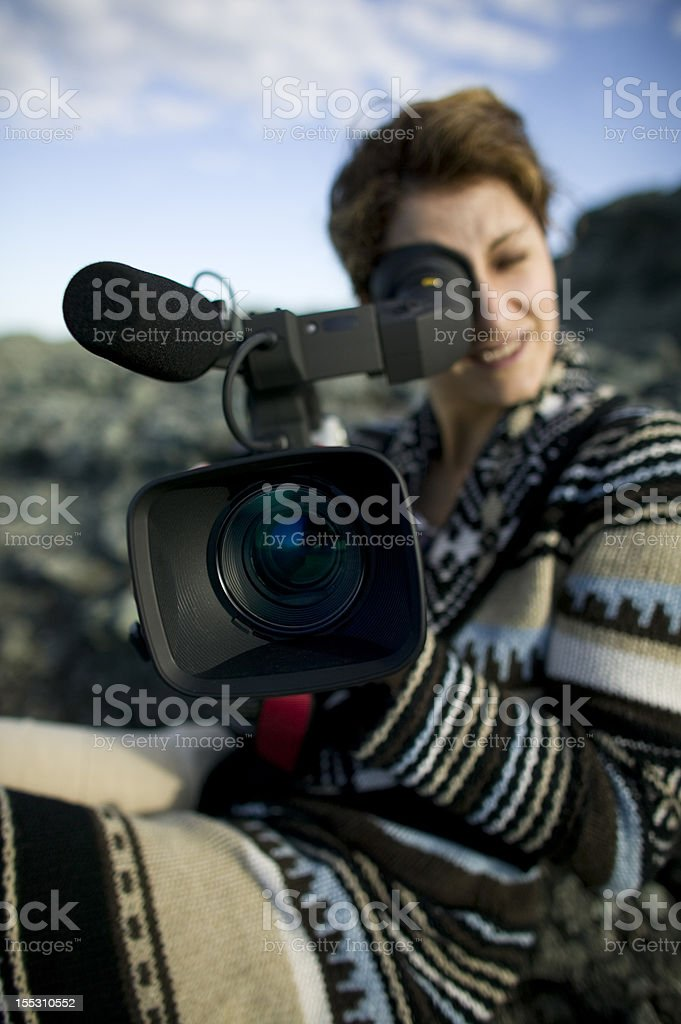 Girl with video camera royalty-free stock photo