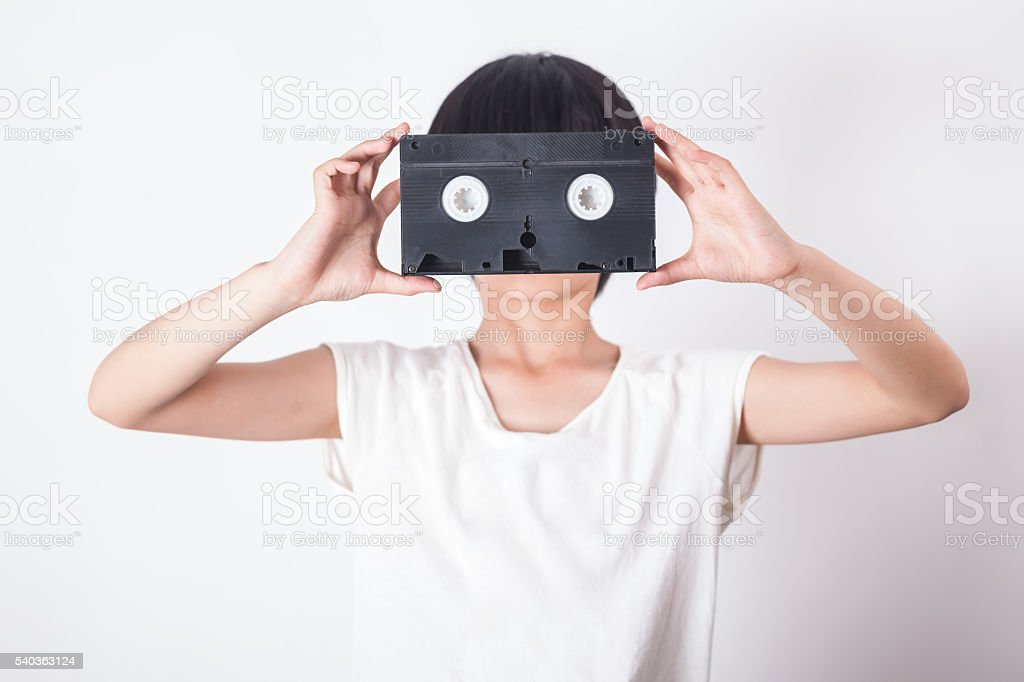 girl with video tape as face stock photo