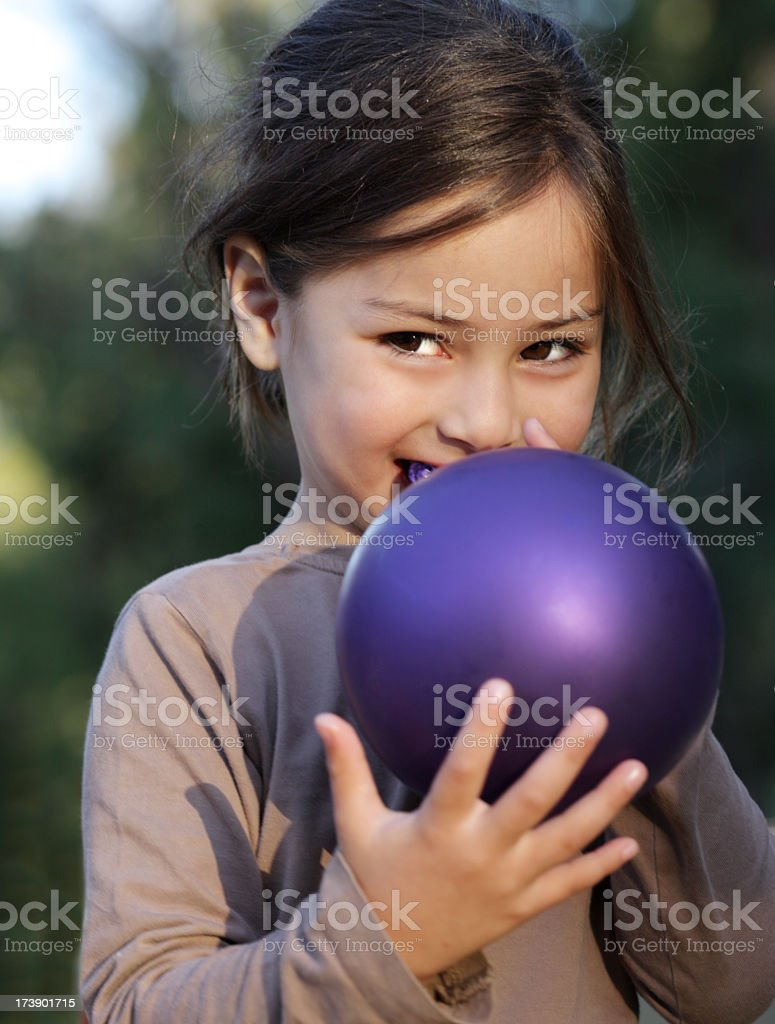 Girl with violet balloon royalty-free stock photo