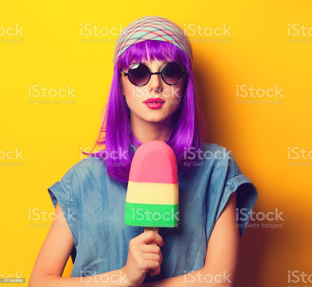 girl with violet hair in sunglasses and ice-cream stock photo
