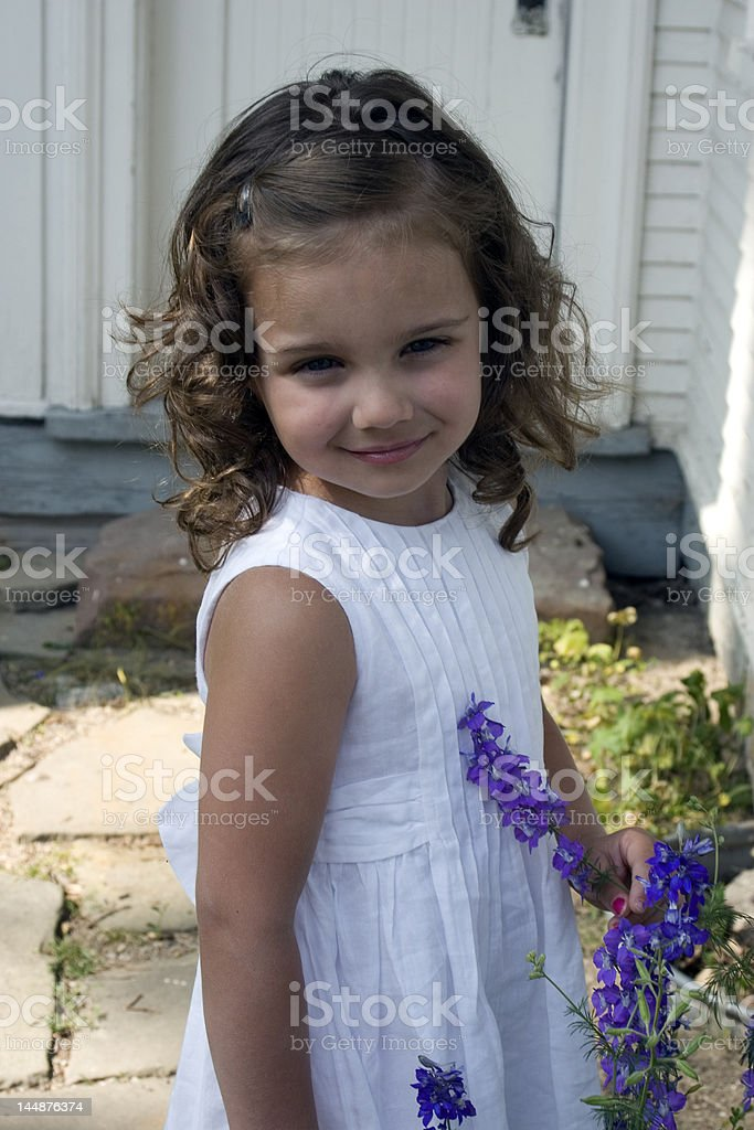 Girl with violets royalty-free stock photo