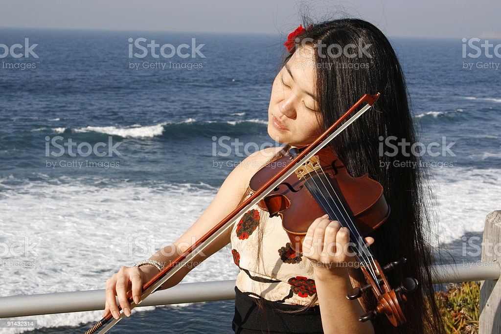 Girl with violin stock photo