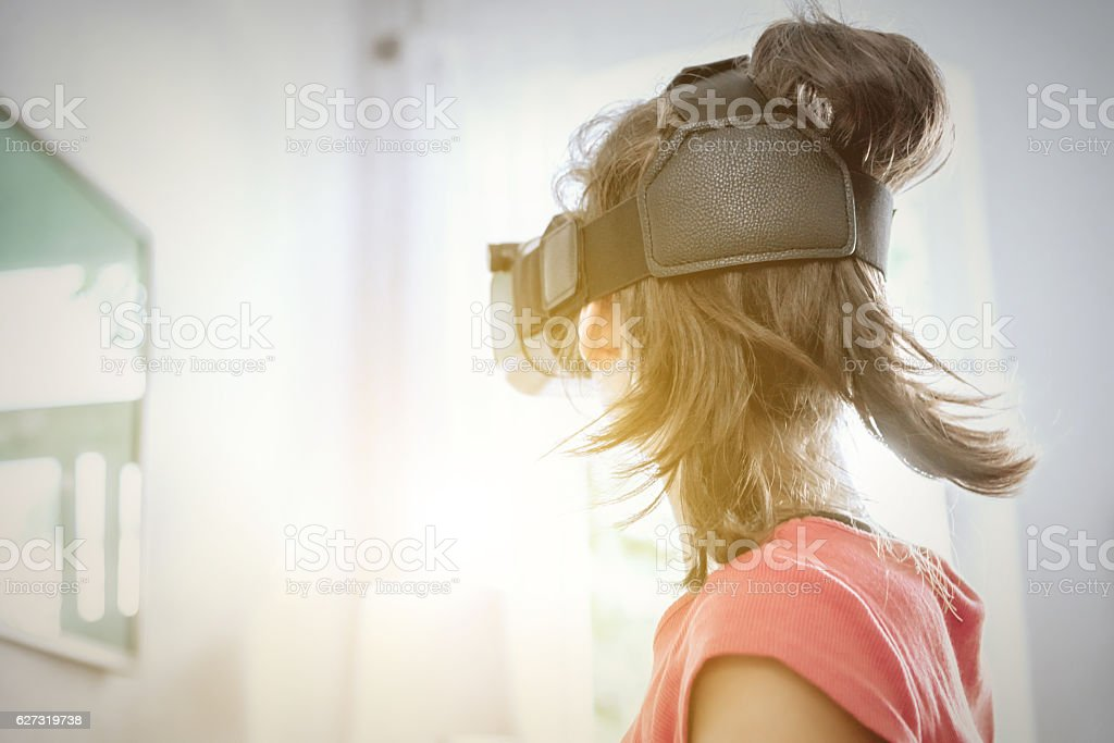 girl with virtual reality simulator in  indoor stock photo