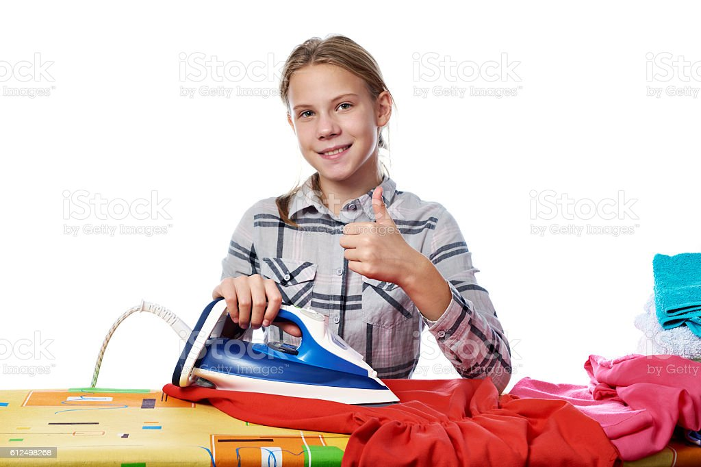Girl with washed linen around ironing board and iron isolated stock photo