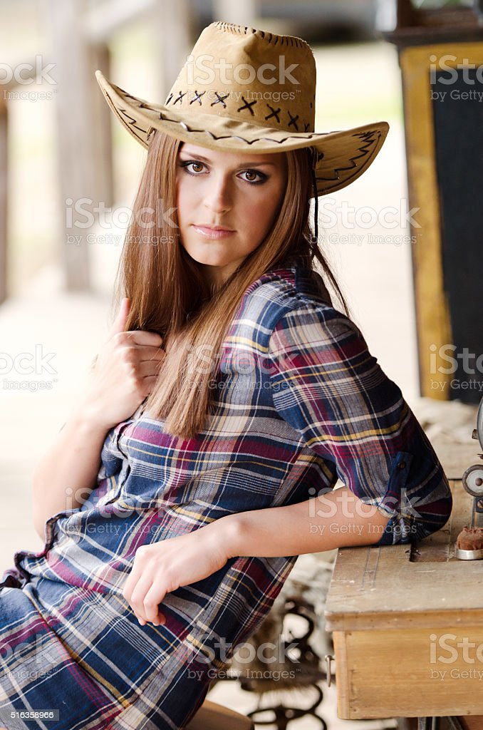 Girl with western hat stock photo