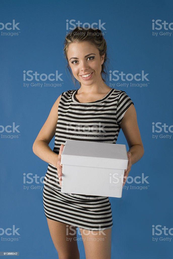 Girl with White Box stock photo