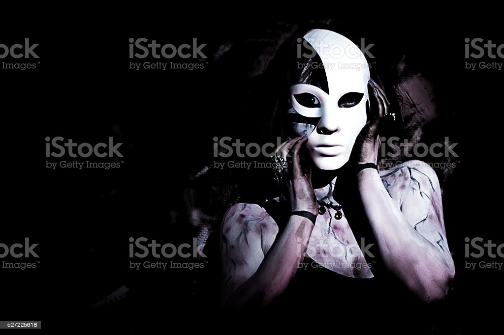 girl with white mask on black background stock photo