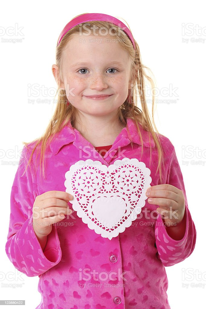 girl with white paper heart stock photo