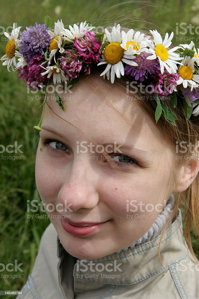 girl with wreath of wild flowers royalty-free stock photo
