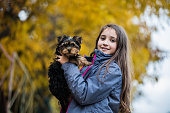 Girl with Yorkshire dog