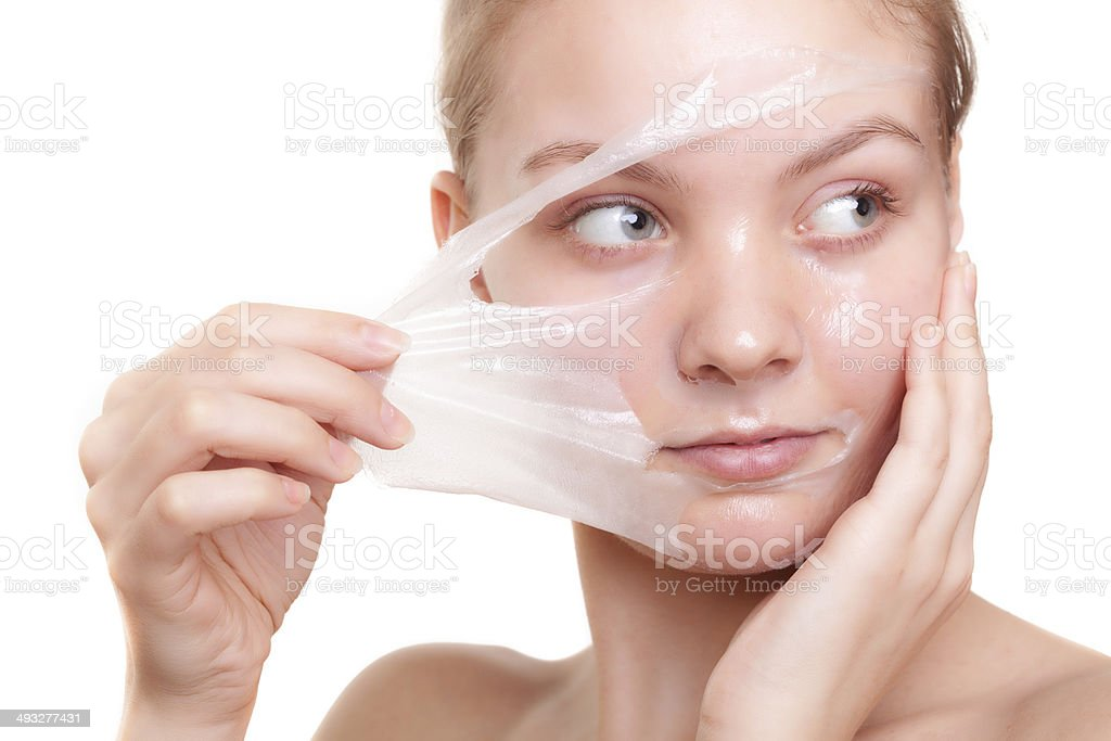 Girl woman in facial peel off mask. Skin care. stock photo