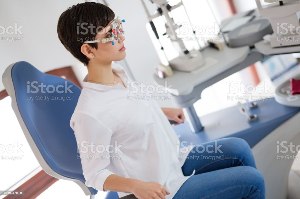 Girl woman in ophthalmology clinic for diopter detection stock photo
