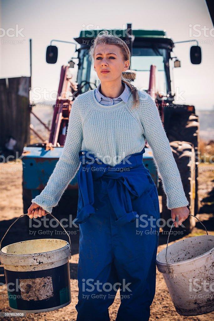 Girl Working Hard on the Farm stock photo