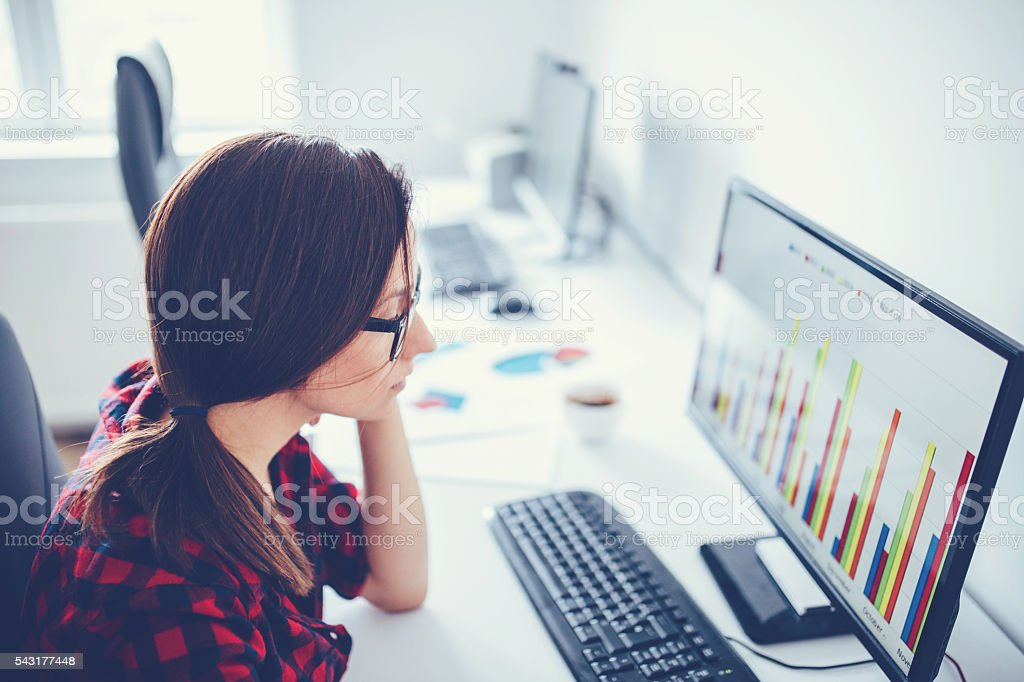 Girl working in office stock photo