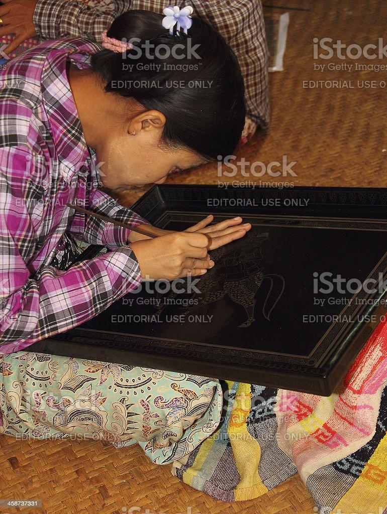 girl working on lacquerware stock photo