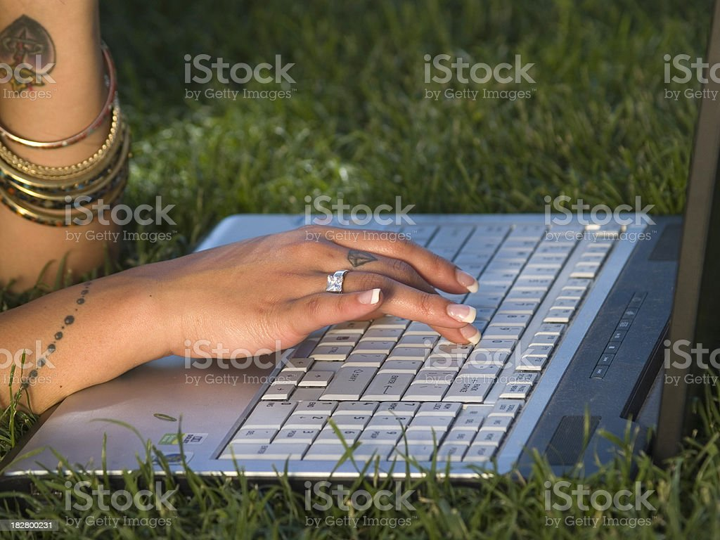 Girl working with computer in the park. royalty-free stock photo