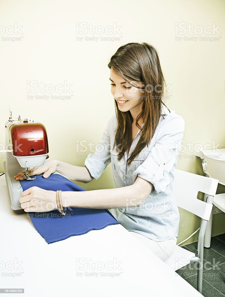 Girl working with sewing machine royalty-free stock photo