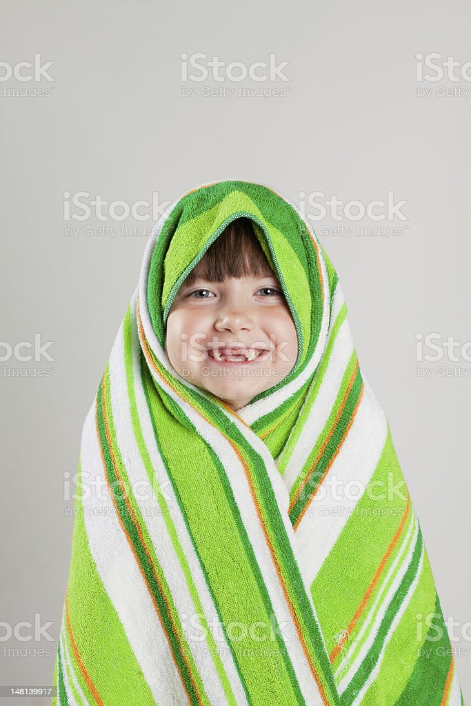 Girl wrapped in towel stock photo