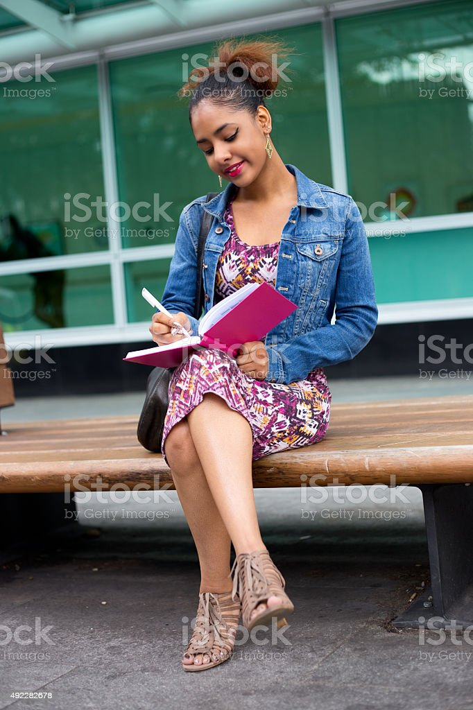 girl writing in diary royalty-free stock photo