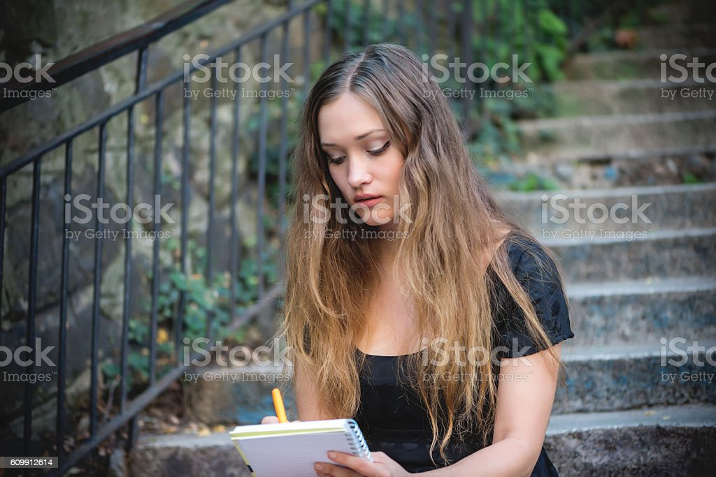 Girl wrote in the diary stock photo