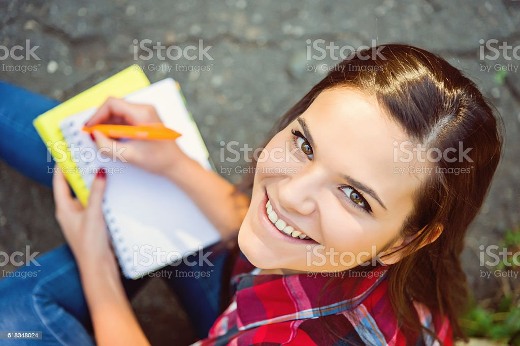 Girl wrote in the notebook stock photo