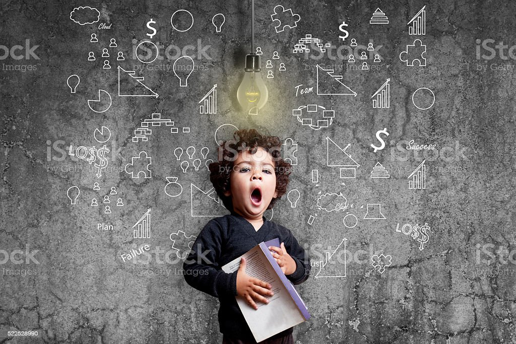 Girl yawning during study against dirty wall stock photo