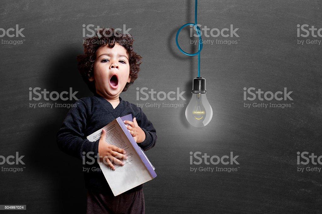 Girl yawning during study stock photo