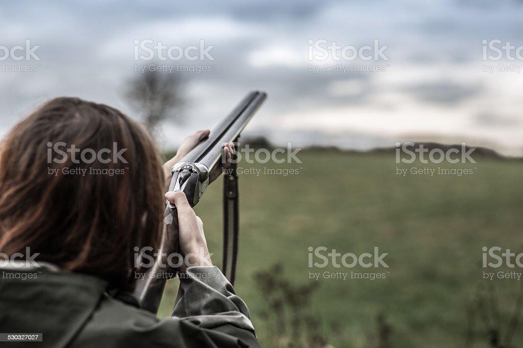 Girl_shoot_skeet stock photo