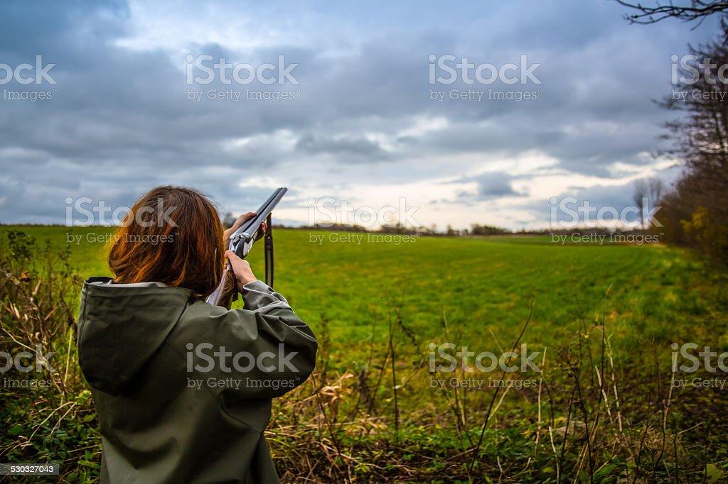 Girl_Shoot_skeet_2 stock photo