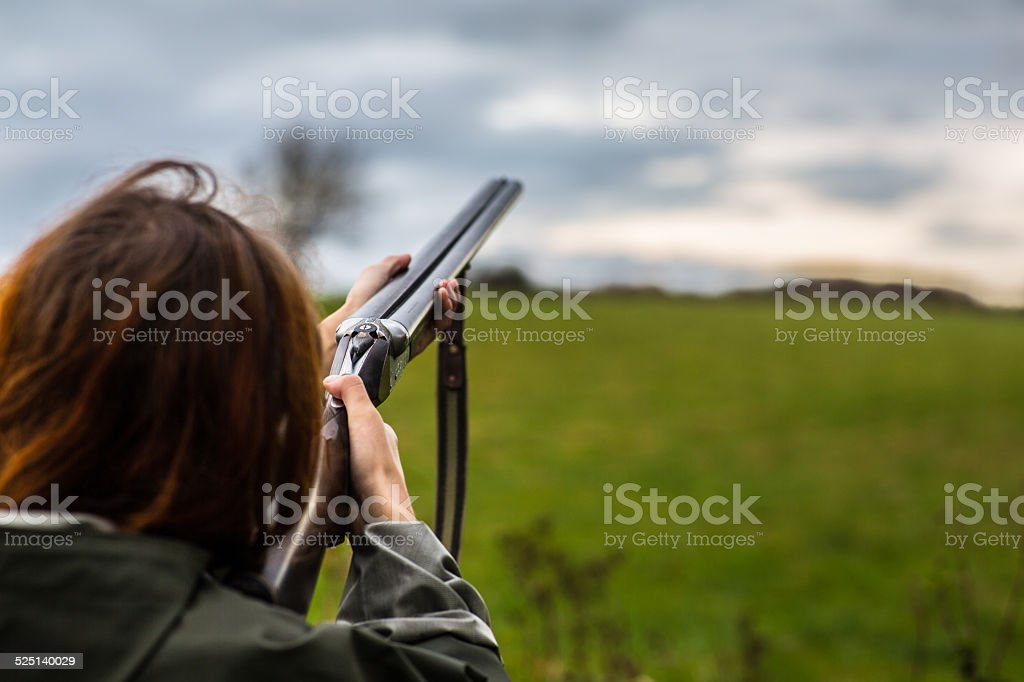 Girl_shotgun_skeet stock photo