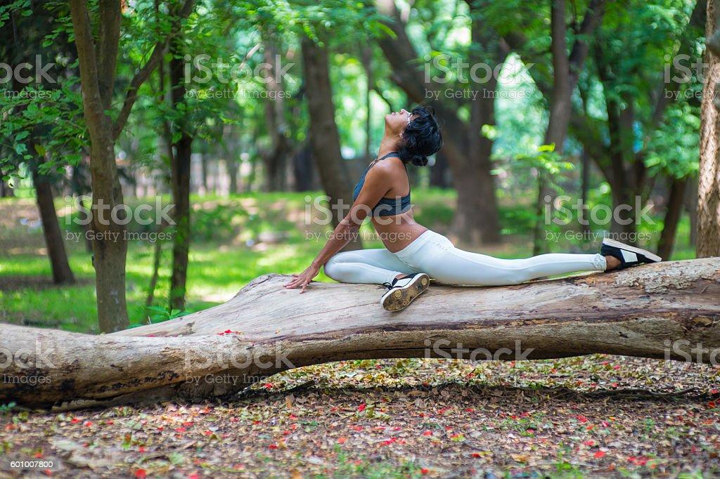 Girl_Yoga_Strech_Forest stock photo