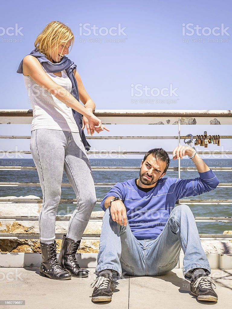 Girlfriend mocking handcuffed Boyfriend royalty-free stock photo