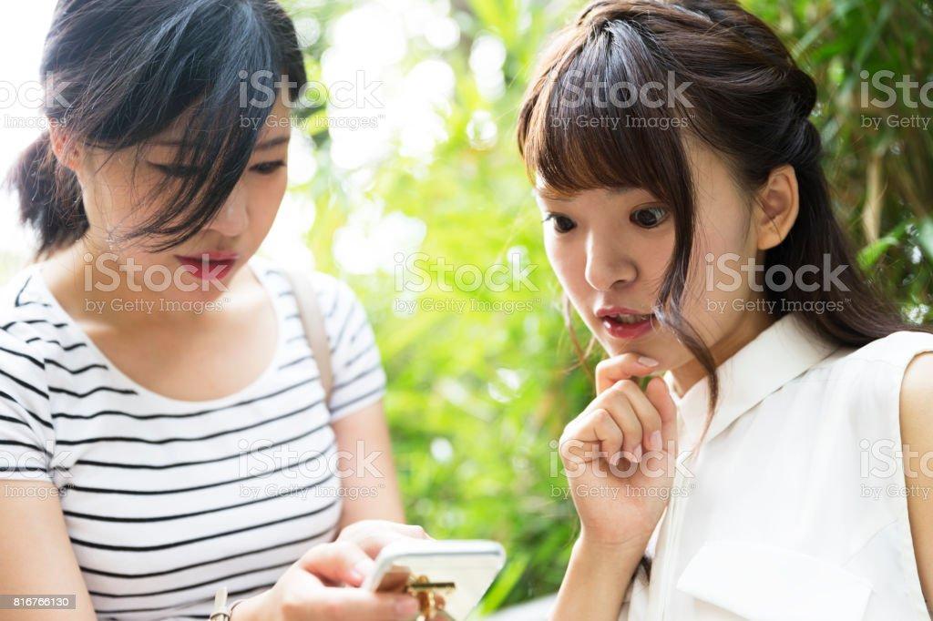 Girlfriend seem shocked looking at social media feed stock photo