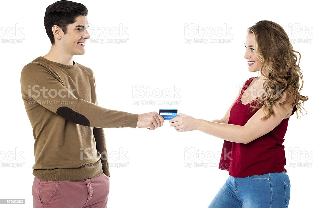 Girlfriend sweetly snatching credit card stock photo