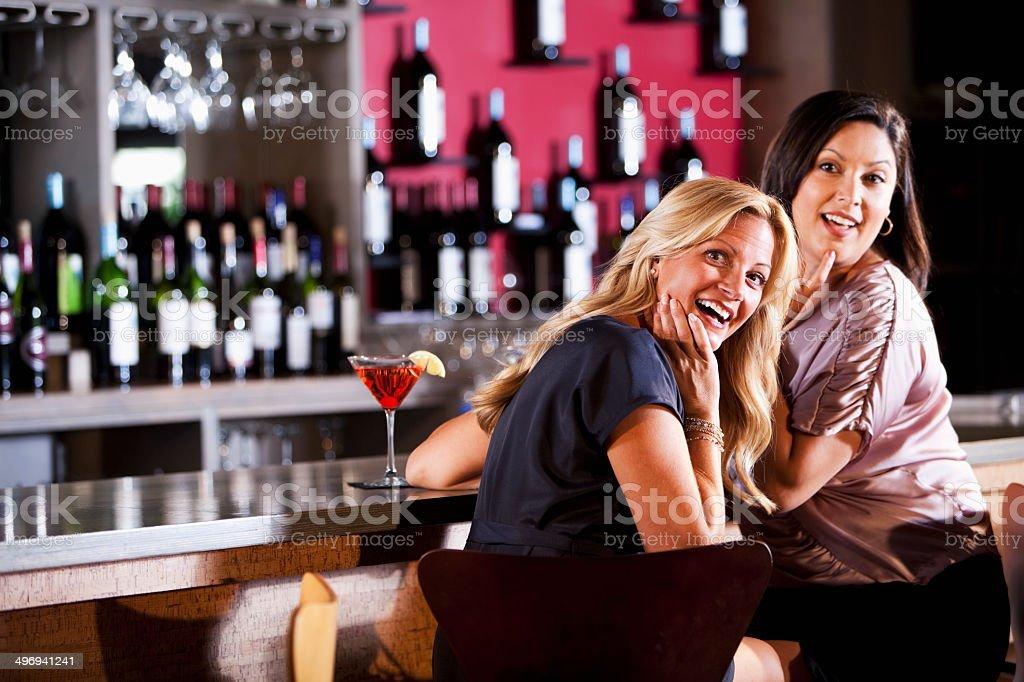 Girlfriends at bar stock photo