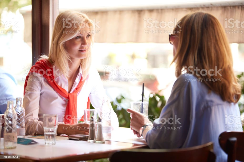 Girlfriends at coffee shop stock photo