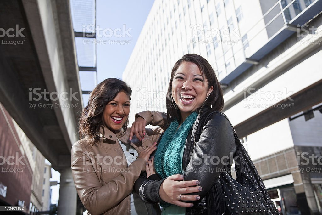 Girlfriends in the city stock photo