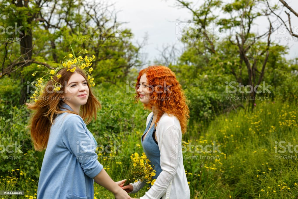 Girlfriends meeting in park. stock photo