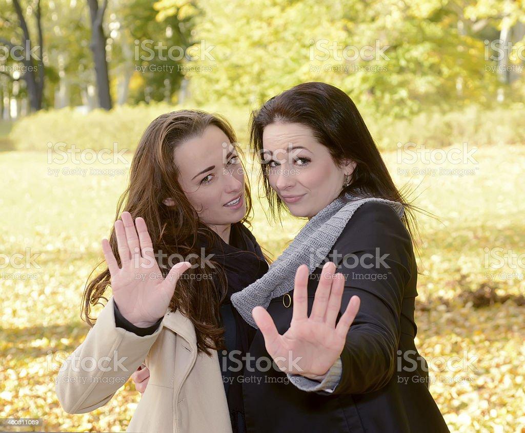 girlfriends showing stop stock photo