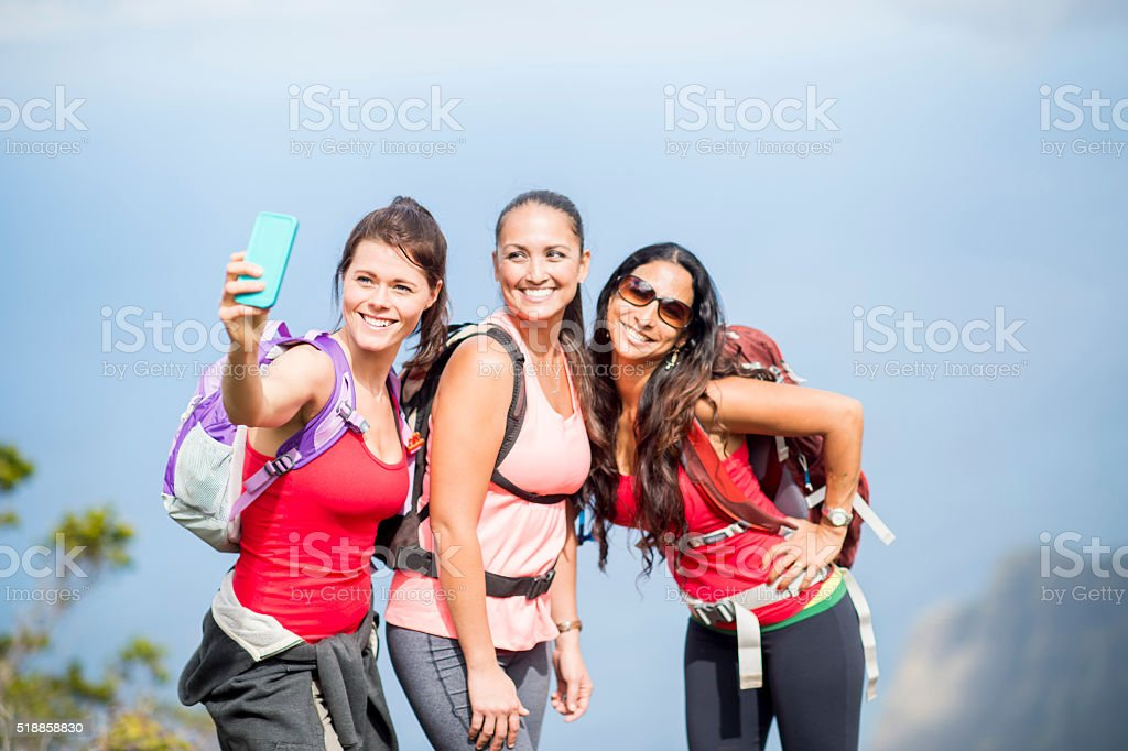 Girlfriends Taking a Selfie on Hawaiian Mountain stock photo