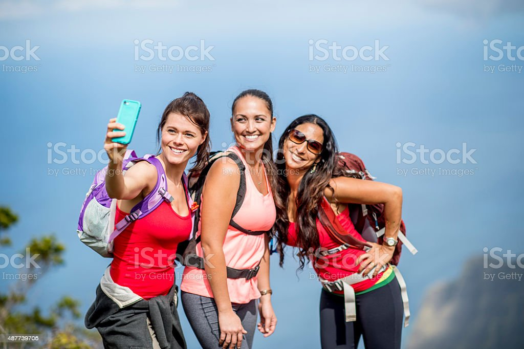 Girlfriends Taking Selfie in Hawaii stock photo